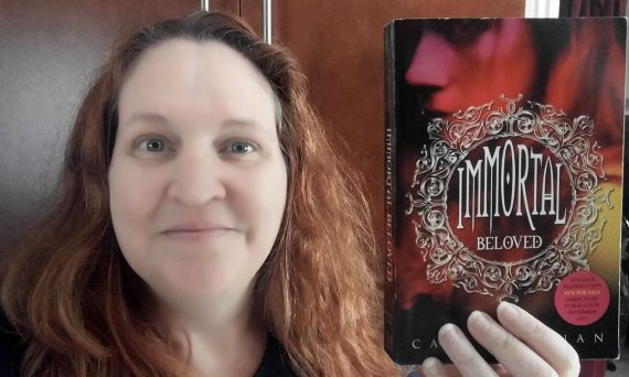 Carma Spence holding an advance reading copy of Cate Tiernan's Immortal Beloved