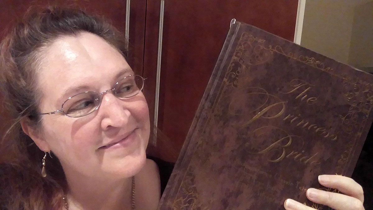 Carma Spence holding a copy of The Princess Bride Deluxe Edition