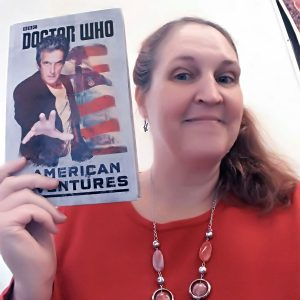 Carma, The Genre Traveler, with the book, Doctor Who: The American Adventures