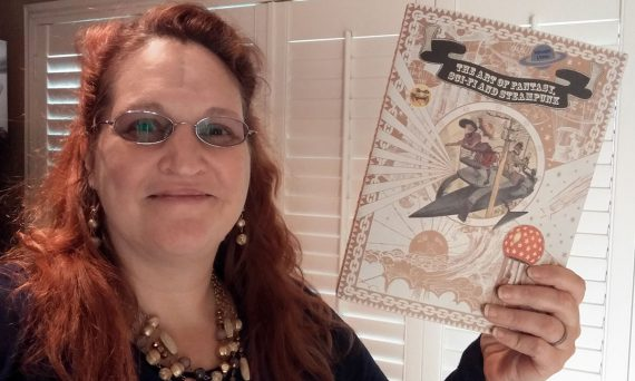 Carma Spence holding a copy of The Art of Fantasy, Sci-fi and Steampunk