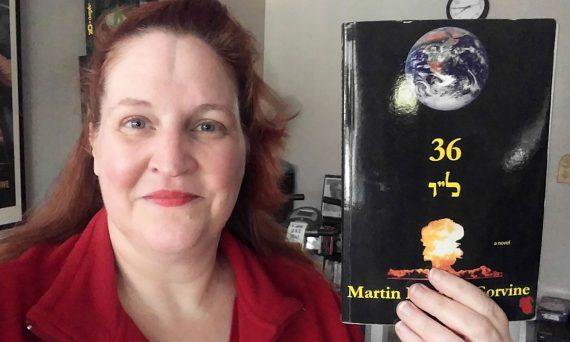 "Carma holding a copy of ""36"" by Martin Berman-Gorvine"